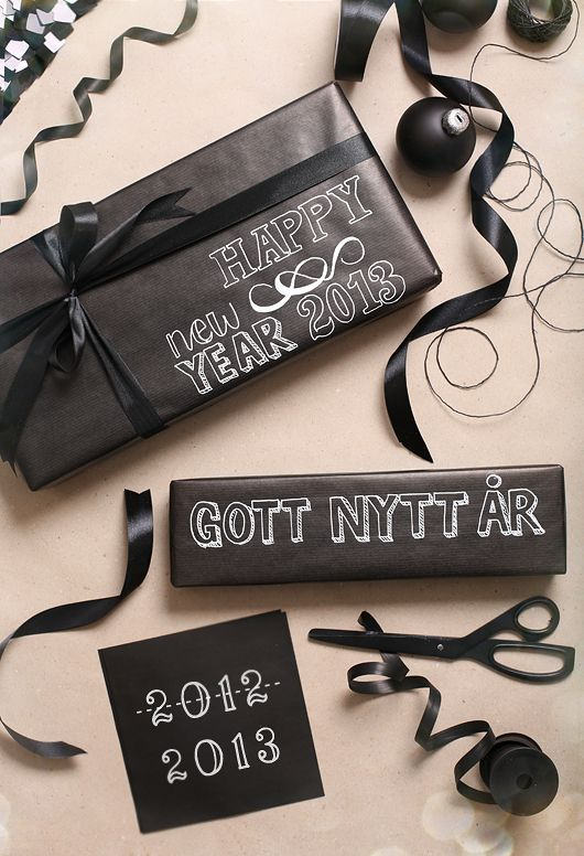how nice looking, black wrapping paper, paint on words. not just a new years thing. how about speciality wrapping paper for a kid with his/her name on it. :)