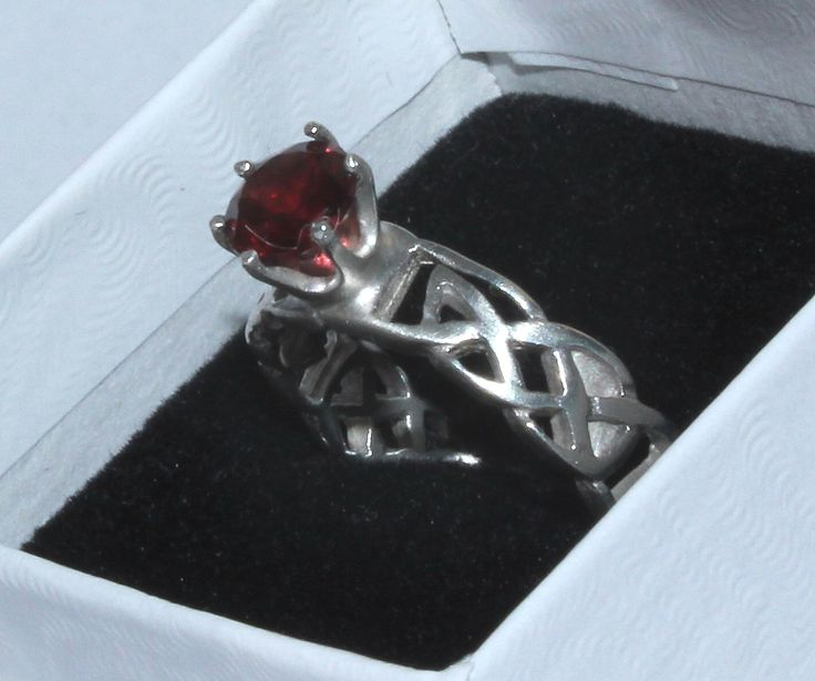 Celtic Ring with red garnet Size 7 by JVJEWELERS on Etsy https://www.etsy.com/listing/291032135/celtic-ring-with-red-garnet-size-7
