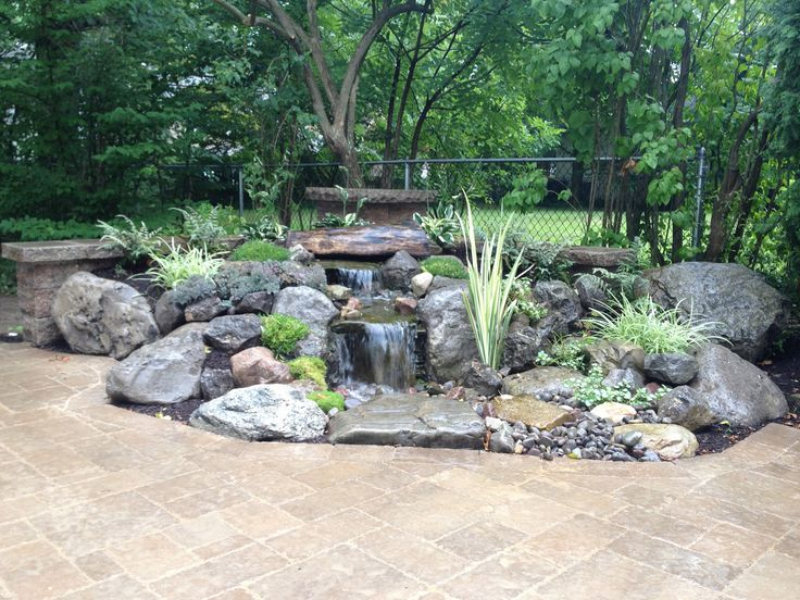 Pondless Waterfalls Water Feature Landscape Design With Paver Patio Pillars And Sitting Wall