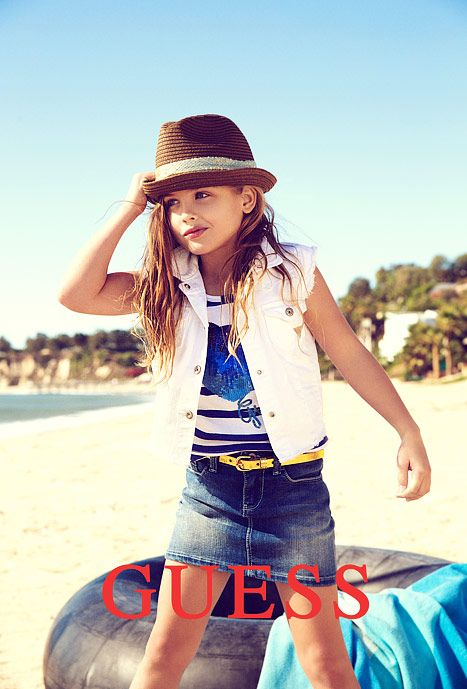 Dannielynn Birkhead is ready for her closeup.  Two decades after her mother became a world-famous model for GUESS  -- and five years after her untimely death -- the six-year-old daughter of Anna Nicole Smith makes her modeling debut for GUESS kids.  In the ad, the pretty little girl strikes a pose on the beach as she wears a denim mini-skirt, white-denim vest, graphic t-shirt and a fedora.