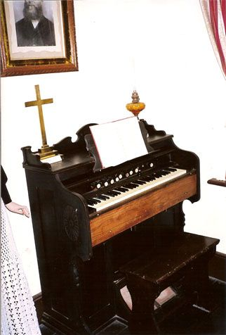 The organ and cross from St James' Anglican Church, South Greenough.