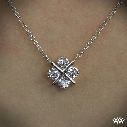 "XO Diamond Pendant Cross our hearts...and arrows diamonds. The ""XO"" Diamond Pendant shines with 4 A CUT ABOVE® Hearts and Arrows Diamond Melee"