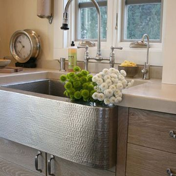 It's a winsome classic, done better. The Farmhouse kitchen sink from Native Trails renews this well-loved traditional design. The intriguing texture of thousands of hammer hits used in its creation is a feast for the eyes. Available in equally stunning Antique or hand-dipped Brushed Nickel finishes.