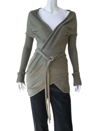Crossed cardigan in ecofriendly cotton, fastened by ribbon, ribbed sleeves, different kind of manufacture, seam on centre back. Price $111.00