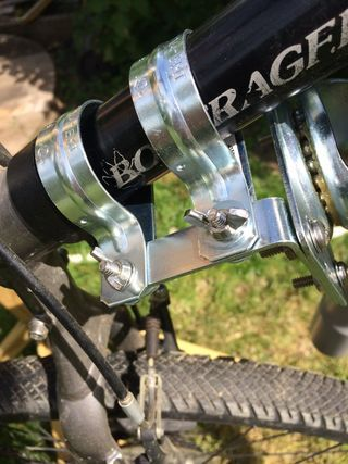 For a while now I have been looking for a bike trailer hitch that would allow full movement by the trailer in both the vertical and side to side lateral directions....
