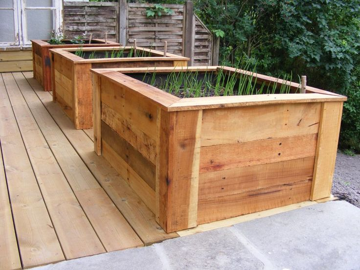 Raised vegetable beds made from pallet wood Link to instructions and video: http://handycrowd.com/how-to/garden-and-outdoors/build-raised-beds-in-garden-out-of-pallets/