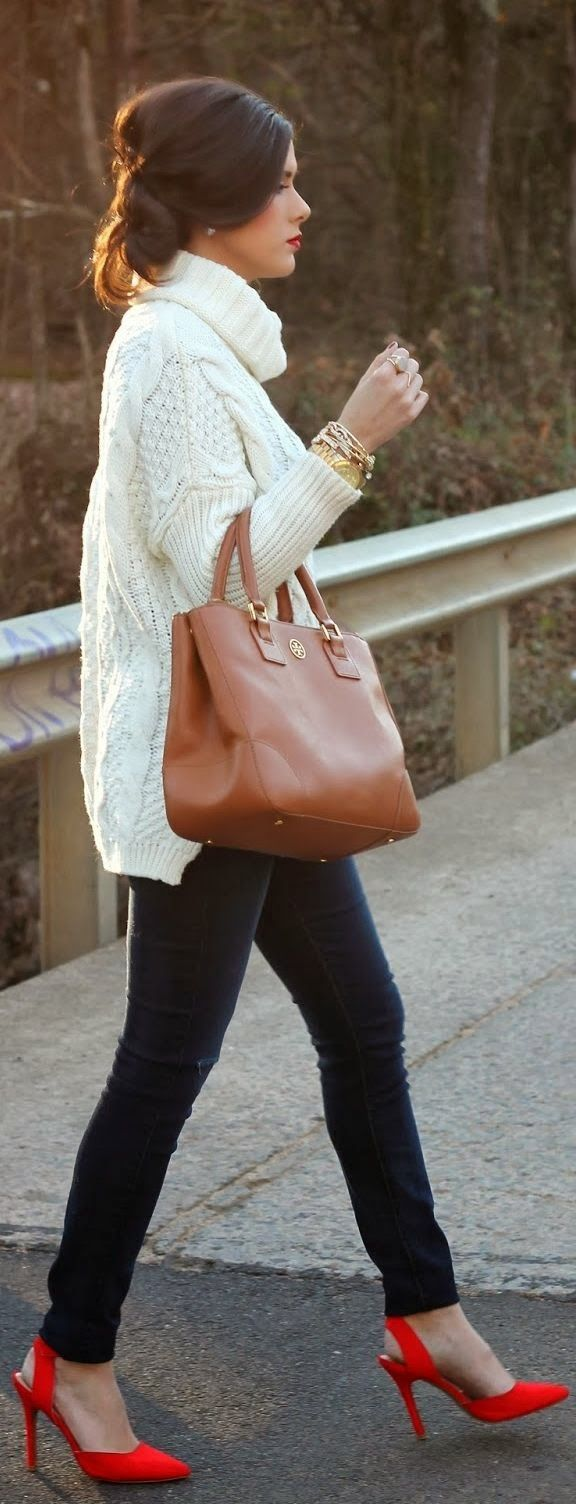Big white cable knit sweater, black slacks, red slingbacks, and a brown leather tote.