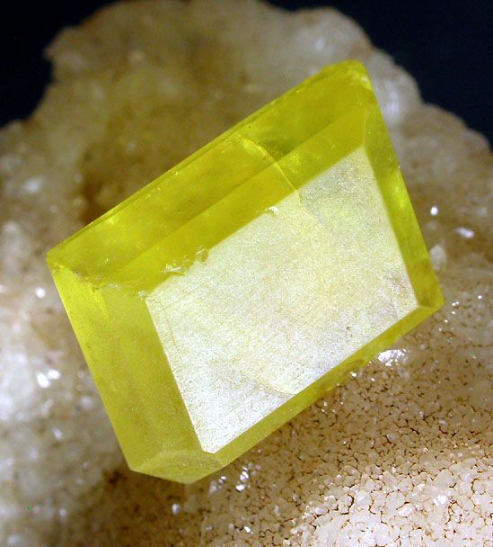 Sulphur on Aragonite. Cozzo Disi Mine, Casteltermini, Agrigento Province (Girgenti Province), Sicily, Italy | Lemon yellow crystal, measuring 15 × 11 × 8 mm. P Haas photograph and collection (no. 12-010).  Copyright © Peter Haas