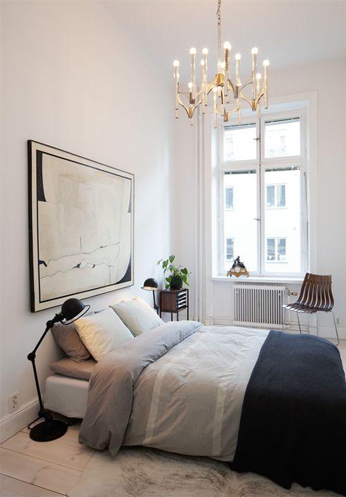 low bed, comfy rug, big art