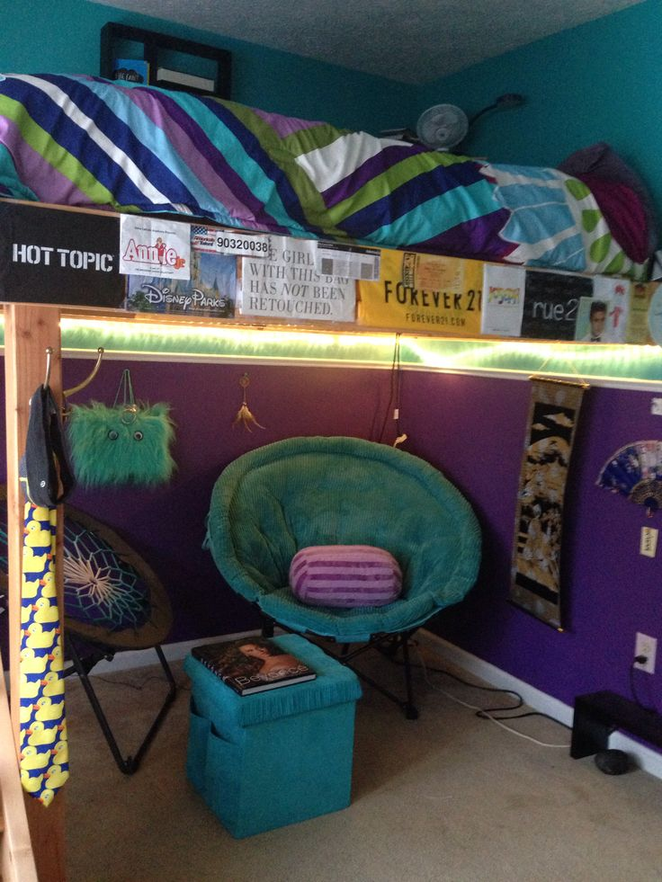 My bedroom: loft bed. Personalized bed frame with shopping bags, concert tickets, etc. Lounge chair, bounce chair, and ottoman underneath, complete with Beyonce biography, Japanese artwork, and string lights. I would some day hope to include curtains and more posters.