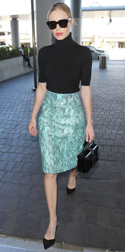 Kate Bosworth was snapped at LAX in another one of her chic jet-setting ensembles. This time she grounded an aqua statement-making Christopher Kane skirt with a black turtleneck, a black Christopher Kane top-handle box clutch, and Paul Andrew sling-backs.