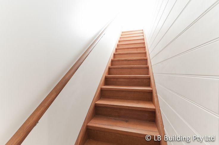 Wooden stair design with wooden handrail by LB Building.