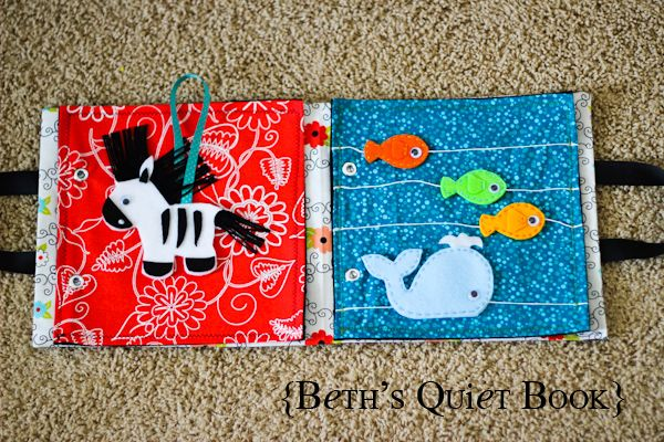 """Quiet book for Henry. Love how the fish and whale can """"swim"""""""