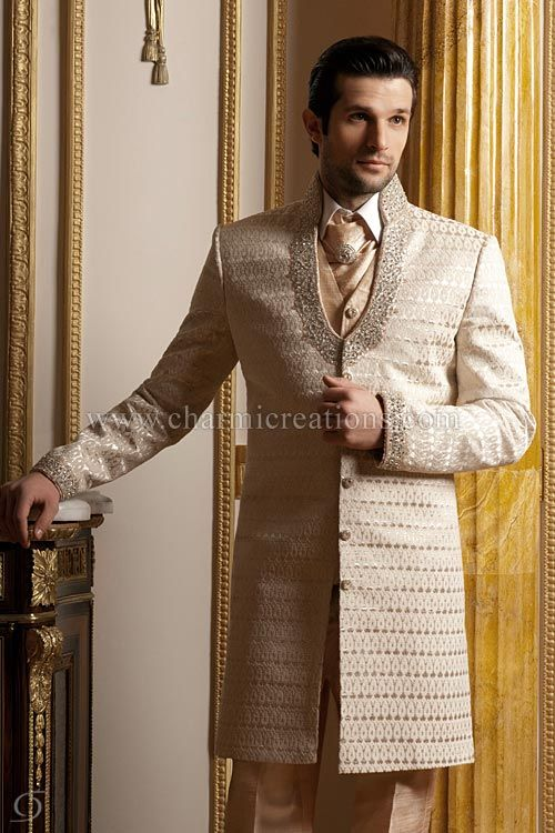 Ivory peach brocade silk wedding suit with an English raw silk waistcoat, cravat and straight English trousers