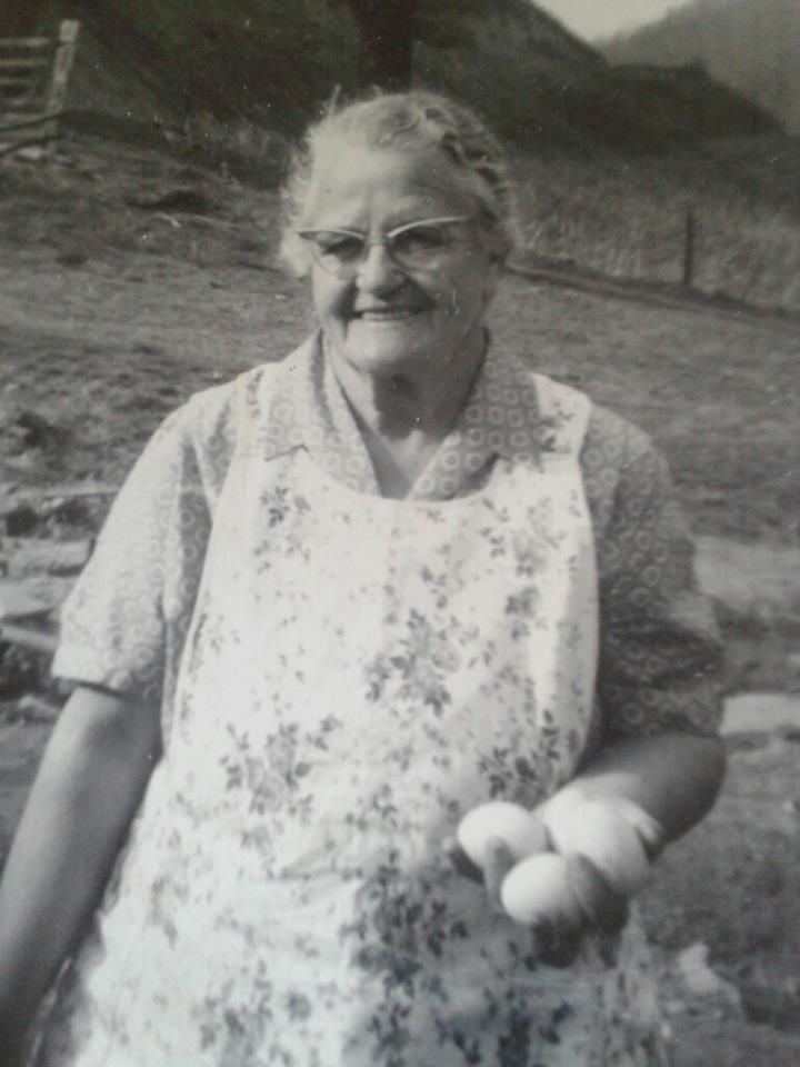 Gathering the eggs... I had to post this picture.. She looks so much like my mamaw.  She was a wonderful lady.. (13 children)