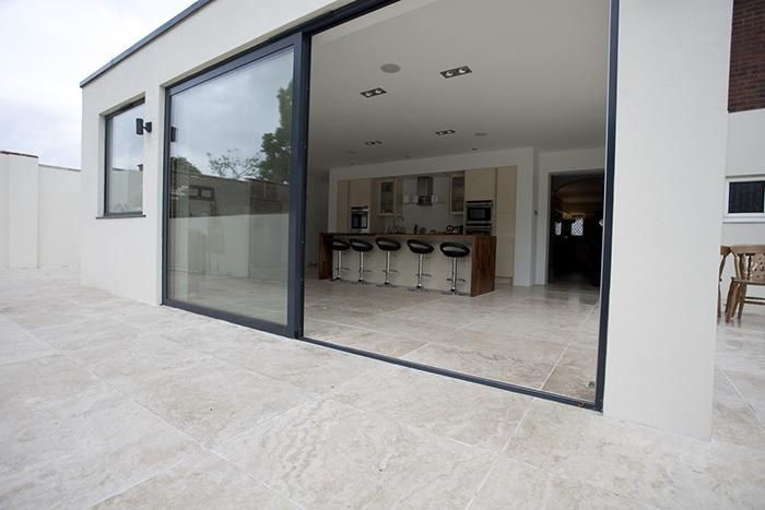 Classic Travertine Paving Filled used in a modern, contemporary garden. The 'inside/outside' look, with bi-fold doors, is extremely popular at the moment and the Travertine lends itself well to this.