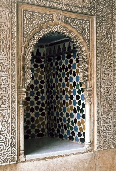 Image SPA 0217 featuring niche from the Alhambra, in Granada, Spain, showing Geometric PatternFloriated Arabesque and Calligraphy using ceramic tiles, mosaic or pottery and stucco or plasterwork.