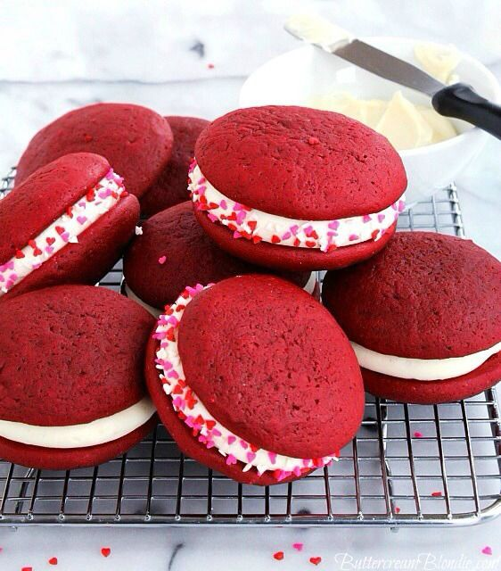 Jacked-up Red Velvet Whoopie Pies - red velvet whoopie pies filled with bourbon cream cheese frosting! | ButtercreamBlondie.com #redvelvet