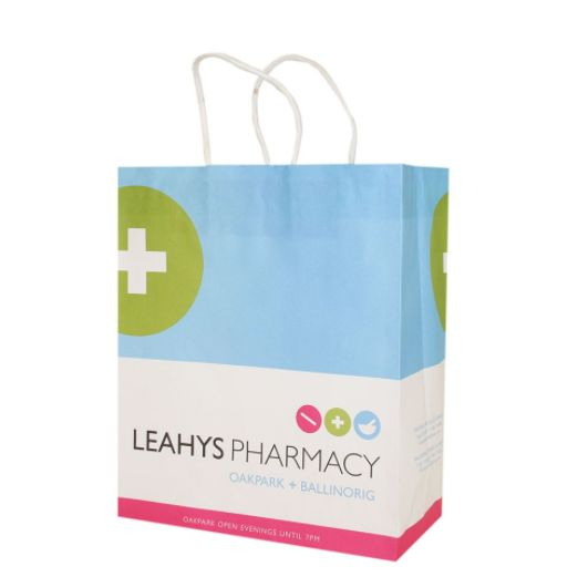 #pharmacybags Leahys Pharmacy wanted a paper bag that would show their pharmacy as an innovative and modern brand. Having simple design and lots of white colour was also important to evoke a feeling of clean and sterile. A bright pink bottom was used to highlight key piece of information - late opening hours.