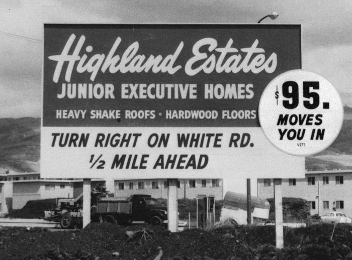 Billboard for Highland Estates, a Kaiser postwar housing development connected to the Panorama City hospital; sign advertises discounts for veterans.
