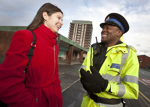 A police community support officer (PCSO) of Greater Manchester Police's Longsight and Ardwick Neighbourhood Policing Team chats with a local resident while on patrol.    Neighbourhood Policing is at the heart of Greater Manchester Police. We want Greater Manchester to be a better place to live, work and play.      For information about Neighbourhood Policing in your area please visit   www.gmp.police.uk