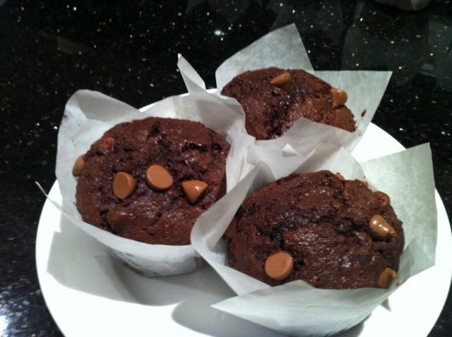 Delicious chocolate muffins with various topping ideas.