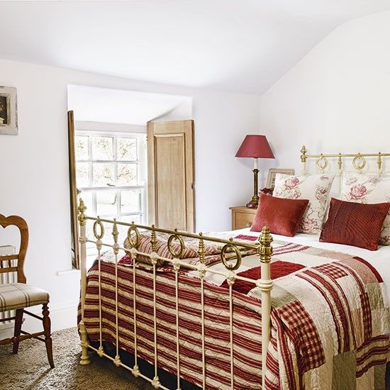 Main bedroom with red and cream accents | Country cottage in Lake District | House tour | PHOTO GALLERY | 25 Beautiful Homes | Housetohome.co.uk