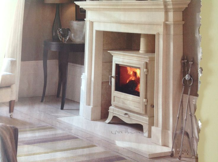 Contemporary wood burner for hearth. Maybe not cream.. Could show dirt/ soot