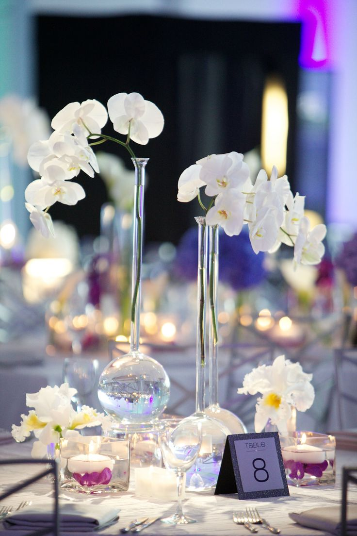 Modern Centerpiece with Beaker Vases & White Phalaenopsis Orchids | Photography: Bob & Dawn Davis Photography. Read More: https://www.insideweddings.com/weddings/modern-purple-blue-white-wedding-at-contemporary-chicago-venue/541/