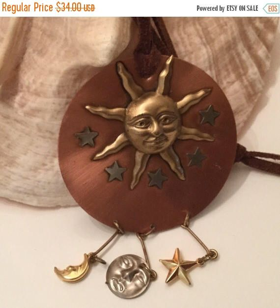 A personal favorite from my Etsy shop https://www.etsy.com/ca/listing/242525483/sale-huge-sun-multi-charm-dangle-pendant
