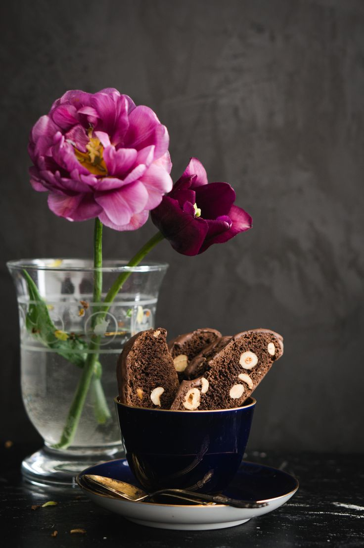 Chocolate cantucci with hazelnuts and pink burgundy tulips