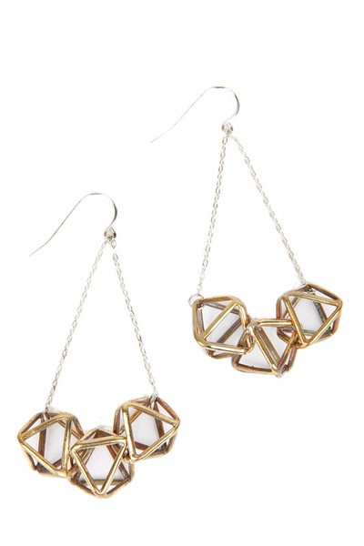 Beyond amazing. And way too cool for a square like me. From here: http://ingodwetrustnyc.myshopify.com/collections/jewelry/products/cage-triple-dangle