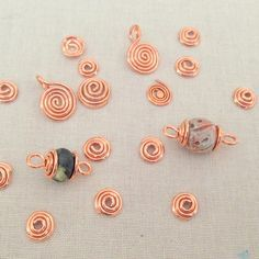 Make wire spirals and bead caps