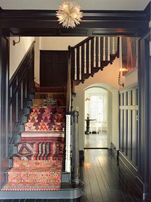 Black Painted Floors/bright handmade rugs