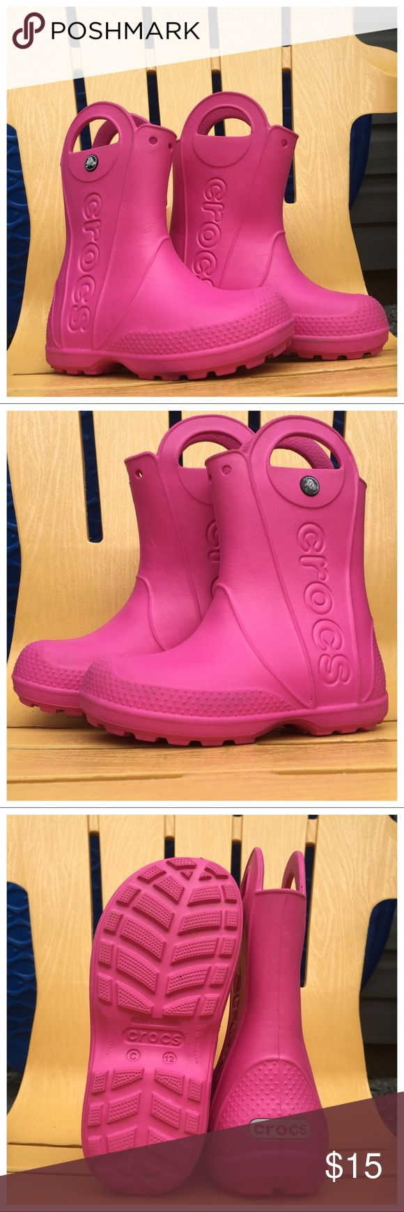 Crocs Handle It Pink Rain Boots Size 12 Even on the rainiest of days, kids can keep their feet looking cool. With the classic comfort of their favorite original Crocs, the Handle It Girls Rain Boot will keep their feet comfy and dry! Size 12 CROCS Shoes Rain & Snow Boots