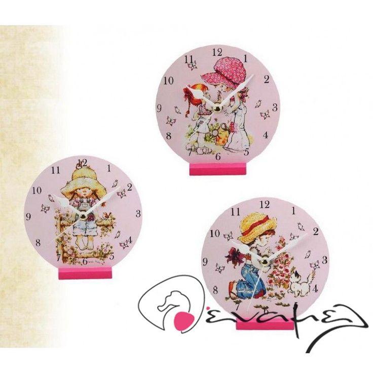 Μπομπονιέρα επιτραπέζιο ρολόι Sarah Kay για βάπτιση με θέμα Sarah Kay. Η τιμή αφορά τεμάχιο - σετ 3 σχέδια μαζί.  Διαστάσεις : 12,5Χ12 εκ  Η τιμή αφορά δεμένη έτοιμη μπομπονιέρα (τούλι και κορδέλες σε χρώμα της επιλογής σας, κουφέτα Χατζηγιαννάκη τυλιγμένα σε ζελατίνα ζαχαροπλαστικής - σημειώστε