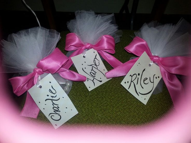 I wrapped the flower girl's bracelets up in tulle, made a name tag and used wire ribbon for  the bow.
