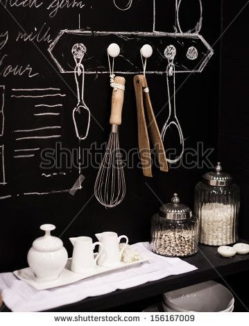 Kitchen cooking utensil on steel rack