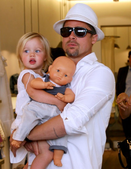 Mr. Brad Pitt working it with his daughter and doll,