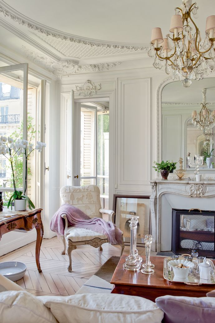 Bright and airy Parisian chic space with luxurios details like chandelier and plaster of Paris