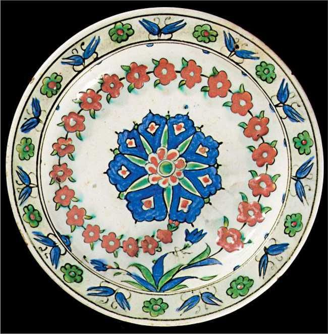 Iznik Tile: An Iznik Polychrome Pottery Wreath of Prunus Blossoms Dish C 1575 Lot 170
