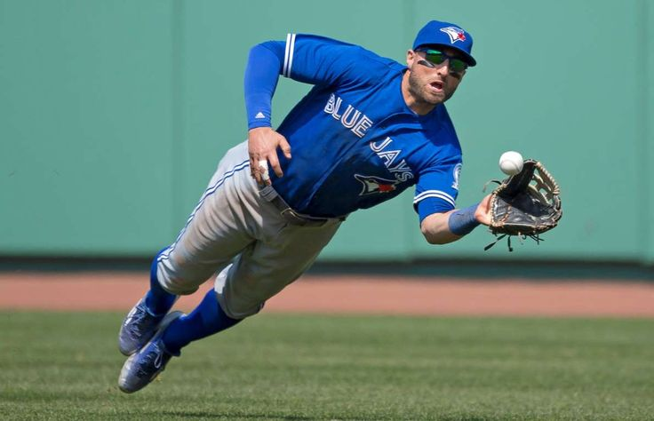 Blue Jay takes flight: Kevin Pillar of the Toronto Blue Jays makes a diving catch against the Boston Red Sox in the eighth inning on April 18 in Boston. The Blue Jays won 4-3. - © Michael Ivins/Boston Red Sox/Getty Images