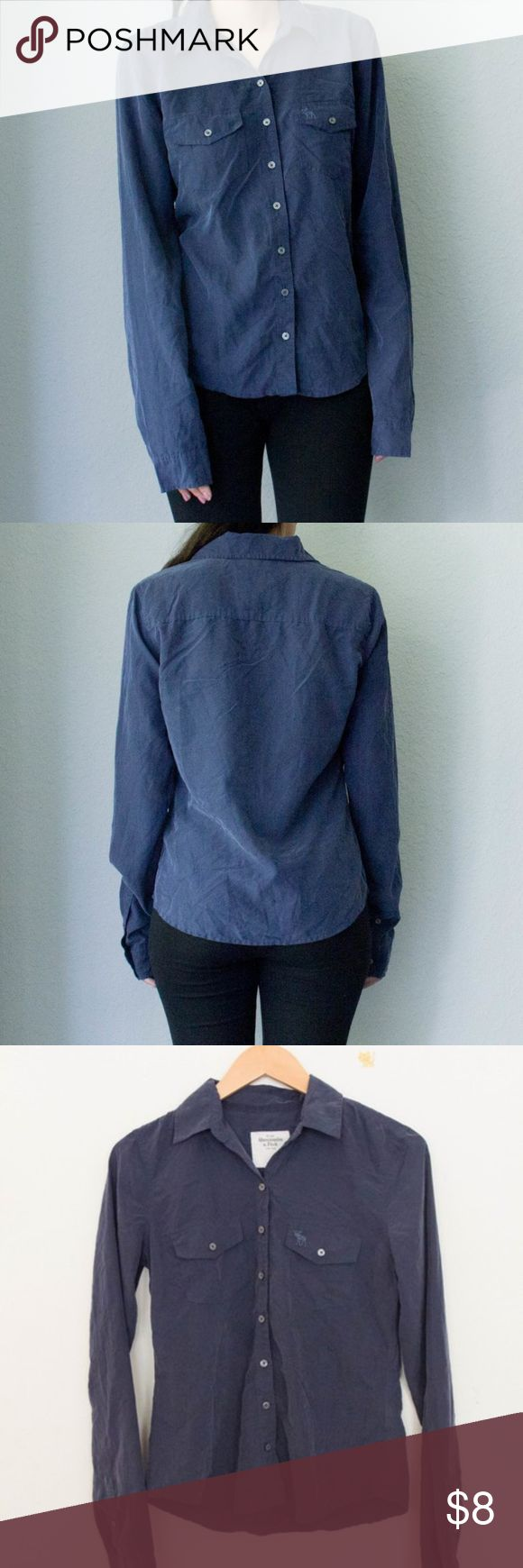 """Grey-Blue Collared Buttoned Top ▹ Color: Grey-Blue  ▹ Condition: Worn twice; in overall great condition!  ▹ Material: Modal, Polyester  ▹ Measurements (Approx): If interested, please ask  ▹ Model Measurements: Bust 32A 