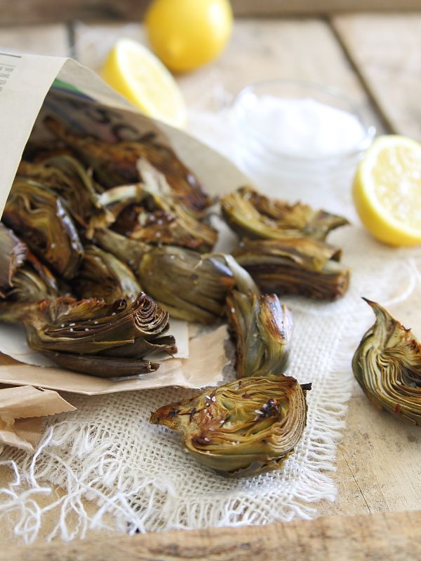 Crispy Lemon Roasted Baby Artichokes: SO delicious and easy - I made these the day I pinned them and they were so good my husband & I devoured them off the baking tray!