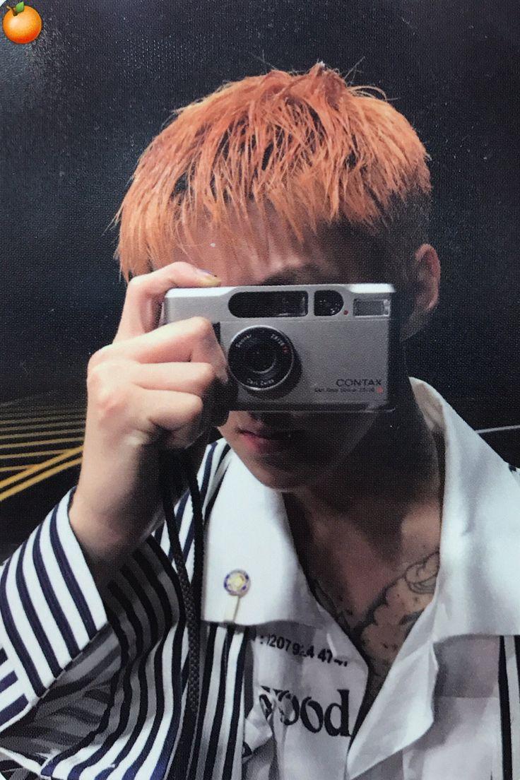 Sehun holding a camera