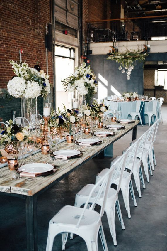 Rustic furniture mixed with floral elements and metallic highlights make a great industrial style for your wedding. #wedding #weddin ...
