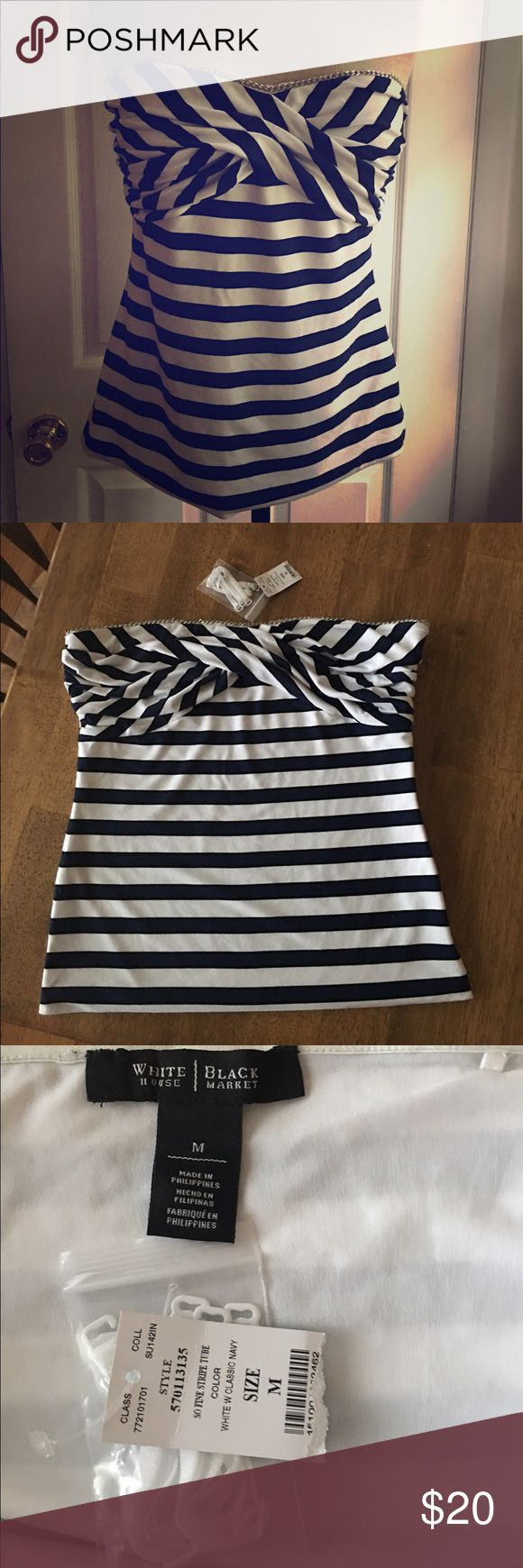 """White House black market navy & white tube top. White House black market navy and white striped tube top. Chain along top of bust, flattering cross cross bust, fully lined with strip along top to help keep in place. Size zip with hook closure, with straps, never worn, excellent condition. Size M 17"""" across bust, plenty of room due to style, 15"""" across waist, 17"""" across hem and  17"""" length. White House Black Market Tops"""