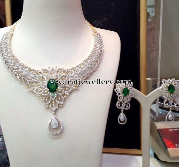Jewellery Designs: Simple Diamond Set with Emerald