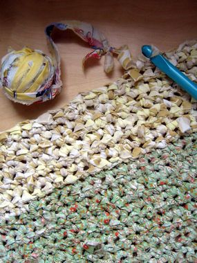 "How to Crochet with Fabric.  Tip: To prevent having a lot of knots in your ""yarn"", cut the fabric in a zig zag."