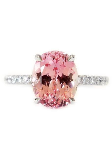Magnificent shades of peach, rose, and apricot make our Fanetta engagement ring a sight to behold. Dana and Rad spent years searching for lab-created padparadscha sapphires that would rival the color, cut and sparkle of their natural counterparts.